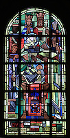 The baptism of Saint Louis, 25th April 1214, with Philippe II Auguste and Ingeburge of Denmark, stained glass window, 1939, by Hollart and Provenzano, surrounding the baptismal fonts in the Chapelle Saint Louis in the Collegiale Notre-Dame de Poissy, a catholic parish church founded c. 1016 by Robert the Pious and rebuilt 1130-60 in late Romanesque and early Gothic styles, in Poissy, Yvelines, France. The chapel windows illustrate the baptism, education and coronation of Saint Louis, or King Louis IX of France, born in Poissy in 1214. The Collegiate Church of Our Lady of Poissy was listed as a Historic Monument in 1840. Picture by Manuel Cohen