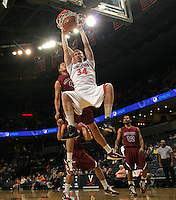 Nov 6, 2010; Charlottesville, VA, USA; Virginia Cavaliers f James Johnson (34) dunks the ball Saturday afternoon in exhibition action at John Paul Jones Arena. The Virginia men's basketball team recorded an 82-50 victory over Roanoke College.