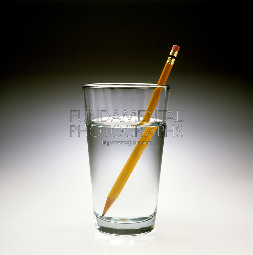 REFRACTION OF LIGHT: Pencil In A Glass Of Water<br /> Due to the refraction light as it moves between mediums of different densities such as air &amp; water, the bottom of the pencil appears to have moved away from the top.