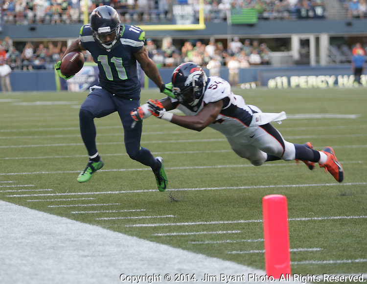 Seattle Seahawks wide receiver Percy Harvin (11) is chased out of bounds by Denver Broncos linebacker Brandon Marshall (54)  at CenturyLink Field in Seattle, Washington on September 21, 2014. The Seahawks won 26-20 in overtime.    ©2014. Jim Bryant Photo. All rights Reserved.