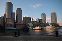 BOSTON, MA.-Views of Rowe's Wharf and Boston's Financial District from the Moakley Courthouse section of the Harborwalk in South Boston.