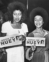 Justice for Black Panther leader Huey Newton.Elaine Brown and Guen Newton holding signs. (1977 photo)<br />