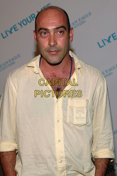 """JOHN VENTIMIGLIA.American Eagle Outfitters' """"Live Your Life Contest"""" winners at the Union Square flagship store in Manhattan, New York, New York..July 27th, 2005  .Photo Credit: Patti Ouderkirk/AdMedia.half length marlboro cigarettes blue beaded necklace.www.capitalpictures.com.sales@capitalpictures.com.© Capital Pictures."""