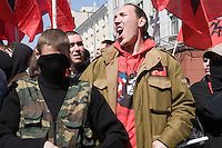 Moscow, Russia, 01/05/2006..Members of Red Youth Vanguard [AKM] block a city centre street to prevent a march by Russian fascists. A variety of political groups took to the streets on the traditional Mayday holiday.