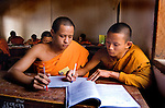 Novice Buddhist monks in clas at a Buddhist school run by monks in Luang Prabang, Laos.