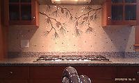 This custom kitchen features a handmade Pinecone mosaic backsplash with River Run background shown in Botticino, Aegean Brown, Jura Green, Gascogne Blue from New Ravenna.<br />
