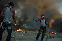 Port Au Prince, Haiti, Jan 22 2010.In the absence of a functiioning state, local 'gangs' are taking over neighborhood security and cleanliness: cleaning up a market square in front of the collapsed Cathedrale Notre Dame..