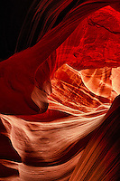 Though the slot canyons carved through Navajo Sandstone often share similar structure and features, each is a unique work of art that constantly changes through time with each passing flash flood. Secret Canyon offers a passage that is not always obvious to the eye...Secret Canyon is a remote slot canyon on the Navajo Reservation accessible only with a guide from Slot Canyon Hummer Tours in Page, Arizona who will drive you across a forbidding off-road trail of sand and slickrock. Unlike Antelope Canyon, which can receive hundreds of visitors a day, Secret Canyon offers an experience of solitude and wonder...Navajo Sandstone formed from the petrified sand dunes of a large Jurassic desert similar to the Sahara Desert of today that often become the richest canvas for the flash floods to carve their masterpieces through.