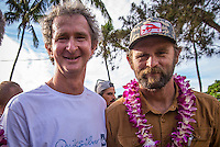 Waimea Bay, North Shore of Oahu, Hawaii.  December 4 2014) Mark Richards (AUS) and Keith Malloy (USA). - The Opening Ceremony of the 2014 Quiksilver In Memory of Eddie Aikau contest was held this afternoon in the park at Waimea Bay. This winter, the big wave riding event celebrates a special milestone of 30 years. <br /> The Quiksilver In Memory of Eddie Aikau is a one-day big wave riding event that only takes place if and when waves meet a 20-foot minimum height, during the holding period of December 1 through February 28, each Hawaiian winter. The official Opening Ceremony with the Aikau Family will be held on Thursday, December 4th, 3pm, at Waimea Bay.<br />  <br /> &quot;The Eddie&quot; is the original big wave riding event and stands as the measure for every big wave event that exists in the world today. It has become an icon of surfing through its honor, integrity and rarity.<br />  <br /> The event honors Hawaiian hero Eddie Aikau, whose legacy is the respect he held for the ocean; his concern for the safety of all who entered it on his watch; and the way with which he rode Waimea Bay on its most giant and memorable days. <br />  <br /> Adherence to strict wave height standards has ensured its integrity; it is only held on days when waves meet or exceed the Hawaiian 20-foot minimum (wave face heights of approximately 40 feet). This was the threshold at which Eddie enjoyed to ride the Bay. It has been said that what makes The Eddie special is the times it doesn't run, because that is precisely its guarantee of integrity and quality days of giant surf.<br />  <br /> The competition has only been held a total of 8 times: it's inaugural year at Sunset Beach, and then seven more times at its permanent home of Waimea Bay. The Eddie was last held on December 9, 2009, won by California's Greg Long.   Photo: joliphotos.com