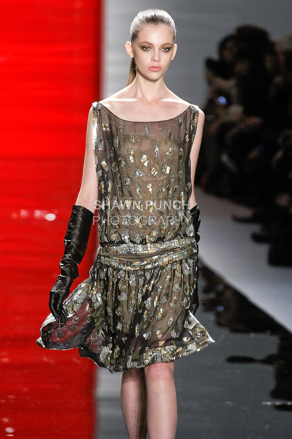 Aline walks runway in a silk chiffon flapper dress with sequin insets, from the Reem Acra Fall 2012 Feminine Power collection fashion show, during Mercedes-Benz Fashion Week New York Fall 2012 at Lincoln Center.