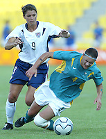 17 August 2004:    Mia Hamm battles for the ball against Dianne Alagich from Australia at Kaftanzoglio Stadium in Thessaloniki, Greece.     USA defeated Australia, 0-0.   Credit: Michael Pimentel / ISI