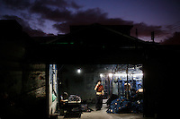 As dawn breaks, a textile manager at a garment factory producing blue jeans contacts a client to inform him that an order is ready. The factory, which specifically carries out a wear-and-tear process used to achieve a fashionable distressed look, produces approximately 10,000 pairs of jeans every day. Thousands of workers labour through the night scrubbing, spraying and tearing jeans in order to meet the production demand. The factory is owned by Huang Dehong, who left his impoverished village and arrived penniless in Zhongshan twenty years ago. China, the &quot;factory of the world&quot;, is now one of the world's largest producers of jeans and its textile workers are among the 200 million migrant labourers criss-crossing the country looking for a better life.