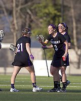 University at Albany defender Stephanie Kempf (21), University at Albany attacker Taylor Frink (3) celebrate their victory. University at Albany defeated Boston College, 11-10, at Newton Campus Field, on March 30, 2011.