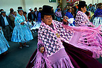 Dancing cholitas, dressed in the traditional indigenous Aymaran clothing of bowler hats, mantas or shawls, and pollera dresses, celebrate Bolivian Independence Day, and Bolivia's patron saint, the Virgin Mary, in Plaza San Francisco, La Paz, Bolivia.