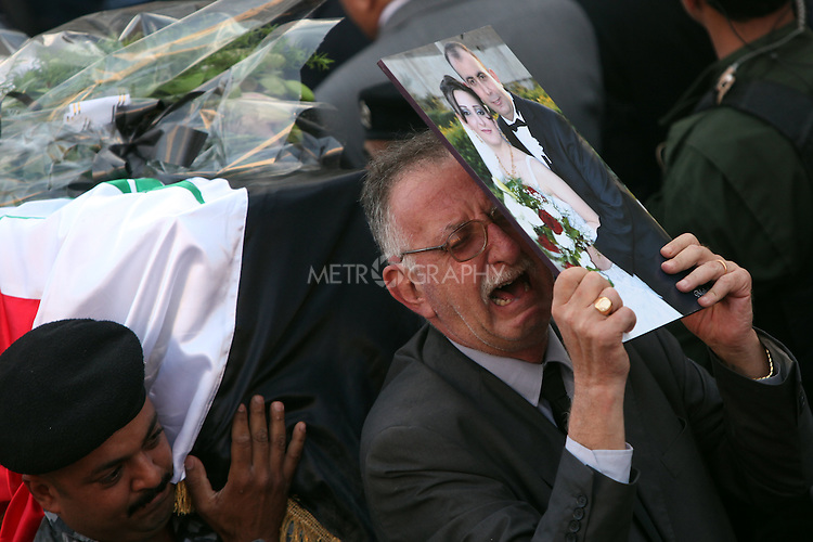 BAGHDAD, IRAQ: A grieving man weeps during the funeral for the victims who died during the siege of the Our Lady of Salvation Catholic Church in Baghdad...At least 52 people were killed when Iraqi troops raided the Our Lady of Salvation Catholic Church where gunmen were holding hostages on Sunday...Photo by Ceerwan Aziz/Metrography