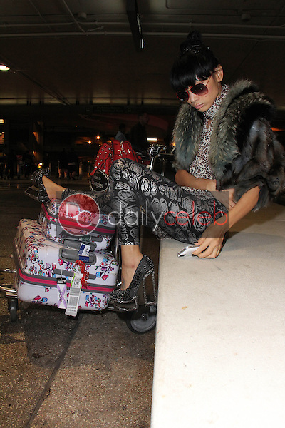 Bai Ling<br /> wears a shirt with the word &quot;GOD&quot; on it while arrivng at LAX, Los Angeles, CA 12-04-14<br /> David Edwards/DailyCeleb.com 818-249-4998