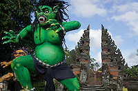 Ogoh-Ogoh sculpture (demon) of Kala Ijo (hijau - green), Pelihatan, Ubud,  Central Bali.  Balinese New Year called Nyepi (around march according to lunar calendar),  is a silent day of meditation and spiritual purification. One day before exorcist rituals are held for purification and balance of polar powers of the universe, first at noon by a priest (exorcism called Caru or Tawur Agung) and later on after sunset in a popular, carneval-like procession of Ogoh-Ogoh, symbolizing bhuta kali (demon, bad spirits,bad habits),  so all the bad spirits leave the village and the island.  Loud, rhythmic music and special performances are part of the procession called Ngerupuk. Road crossings are major spots of exorcism and special ogoh-ogoh performance, since demons often like to dwell here. At Nyepi, the following day, there is 24 hours silence, no vehicle or people on the street, no light or fire, no working - all the bad spirits should think, the island is abandoned and leave the island. Day after Nyepi is a day of reconciliation - new year starts purified.