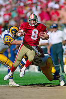 SAN FRANCISCO, CA - San Francisco 49ers quarterback Steve Young in action running for a game winning touchdown during a game against the Los Angeles Rams at Candlestick Park in San Francisco, California on October 25, 1992. Photo by Brad Mangin