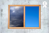 Cloudy and clear sky views framed, on white wall