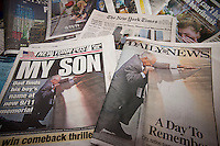 Headlines of New York newspapers are seen on Tuesday, September 13, 2011 reporting on the tenth anniversary of the World Trade Center terrorist attacks. The New York Post and the New York Daily News, competing tabloids, used the same photograph on their front pages. (© Richard B. Levine)