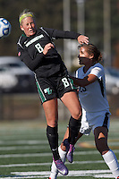 Wilmington University forward Chelsea Grace (8) heads the ball. College of St Rose forward Michaela Phillips (23).. In 2012 NCAA Division II Women's Soccer Championship Tournament First Round, College of St Rose (white) defeated Wilmington University (black), 3-0, on Ronald J. Abdow Field at American International College on November 9, 2012.