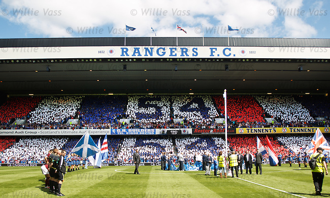 Rangers chairman Craig Whyte unfurls the SPL winners flag for a world record 54th time and a season of chaos is about to unfurl for the giant Glasgow club.