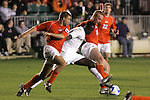14 December 2007: Wake Forest's Marcus Tracy (center) is defended by Virginia Tech's James Shupp (l) and Ben Nason (14). The Wake Forest University Demon Deacons defeated the Virginia Tech University Hokies 2-0 at SAS Stadium in Cary, North Carolina in a NCAA Division I Men's College Cup semifinal game.