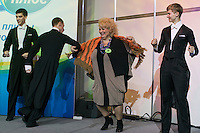 Moscow, Russia, 02/11/2011..A competitors dances onstage at the first Moscow Super-Babushka contest. A total of 105 women aged over 50 entered to compete for various titles, including most stylish, modern, elegant, business-minded, creative, artistic, and cheerful granny. The overall winning title of Super-Babushka was taken by 73 year old Ludmilla Trafinovna in the event organised by the Moscow City Government Social Welfare Department.