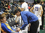 9517<br /> Chiefs' assistant coach Julian Kelly talks James Henderson after their 2A state championship game loss to Petersburg Saturday, March 18, 2017.  Photo for the Daily News by Michael Dinneen