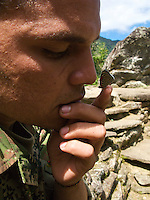 A Colombian soldier shows off how the &quot;98&quot; butterfly likes to tickle his nose - Ciudad Perdida - Colombia