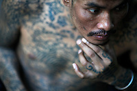 Sontaya, a 39 year-old HIV positive Thai man who claims to have three wives, all HIV positive, rests at a hospice for those dying of AIDS at a Buddhist temple Wat Prabat Nampu in Lopburi on the World AIDS day December 1, 2010. The temple's AIDS hospice is the largest of it's kind in Thailand, providing housing for HIV positive patients and palliative care for those in the final stages of the disease. Thailand has been widely praised for its work in containing the virus.   REUTERS/Damir Sagolj (THAILAND)