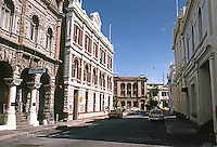Fremantle: Looking down Mouat St. from High St. to Custom House Square. To the left, of rough-hewn limestone, commercial premises, 1902. Photo '82.