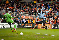 Kei Kamara (23) of Sporting KC collides with Daniel Woolard (21) of D.C. United after a header as Bill Hamid (28) makes the save during the game at RFK Stadium in Washington, DC.  Sporting KC defeated D.C. United, 1-0.