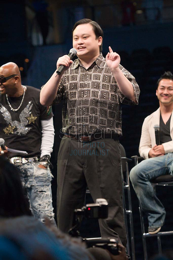 "Former ""American Idol"" contestant William Hung sings during a Dreams N2 Reality show and casting call at Philips Arena in Atlanta on Saturday, August 4, 2007. People offered their auditions in hopes of gaining spots on game shows and others in the reality TV genre. Former ""Real World"" star Syrus (left) and casting director Billy Kemp sit behind."