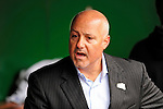 31 March 2011: Washington Nationals General Manager Mike Rizzo chats with media in the dugout prior to Opening Day festivities and game against the Atlanta Braves at Nationals Park in Washington, District of Columbia. The Braves shut out the Nationals 2-0 to open the 2011 Major League Baseball season. Mandatory Credit: Ed Wolfstein Photo