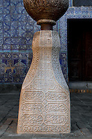 Detail of column and ceramics on the wall, Kurinish Khana or Throne Room, 1804-06, Kukhna Ark, Khiva, Uzbekistan, pictured on July 5, 2010, in the afternoon. The Kukhna Ark is the original home of the Khans. Although its foundations are 5th century, most of the complex is 19th century. The Kurinish Khana (throne room), 1804-06, with its arcade or iwan, is the place where audiences were held in the open air in summer and enclosed by a yurt in winter. Khiva, ancient and remote, is the most intact Silk Road city. Ichan Kala, its old town, was the first site in Uzbekistan to become a World Heritage Site(1991). Picture by Manuel Cohen.