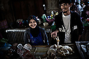 27 year old Maskuri and his wife, Warniti (26) seen shopping at the local Kampung (village) Market in  Suradadi Village in Tegal of Central Java region in Indonesia. Photo: Sanjit Das/Panos