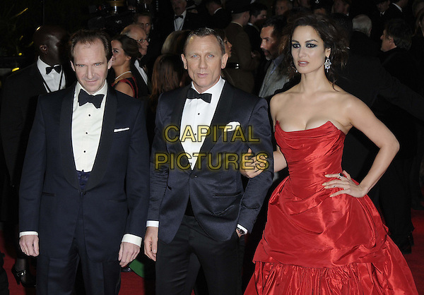 Ralph Fiennes, Daniel Craig, Berenice Marlohe.'Skyfall' Royal World Film Premiere, Royal Albert Hall, Kensington Gore, London, England..23rd October 2012.half length black strapless dress cleavage gathered hands on hips red tuxedo white shirt bow tie.CAP/CAN.©Can Nguyen/Capital Pictures.