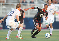 Boyzzz Khumalo #17 of D.C. United  gats away from Jason Pelletier #22 of the Harrisburg City Islanders during a US Open Cup match at the Maryland Soccerplex on July 21 2010, in Boyds, Maryland. United won 2-0.
