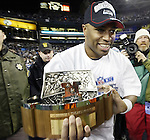Seattle Seahawks running back Shaun Alexander carries the 2005 NFC Championship trophy after the 34-14 victory over the Carolina Panthers at QWEST Field in Seattle. Jim Bryant Photo. ©2010. All Rights Reserved.