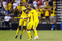 24 JULY 2010:  Andy Iro of the Columbus Crew (6), Leandre Griffit and Danny O'Rourke celebrate Leandre Griffit's first MLS goal in his first MLS game during MLS soccer game between Houston Dynamo vs Columbus Crew at Crew Stadium in Columbus, Ohio on July 3, 2010.