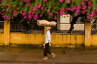 A woman carries freshly baked bread on here head in Siem Reap, Cambodia.