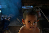 Boy in the kitchen at the Monastery at Angkor Wat, Siem Rep Cambodia