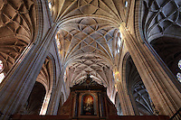 Ceiling of Gothic choir, 15th century, with tracery and high columns, and High Altarpiece, 18th century, by Sabatini, with statue of the Virgen de la Paz, 12th century, in the centre, Segovia Cathedral, (Catedral de Segovia, Catedral de Santa Maria), 1525-77, by Juan Gil de Hontanon (1480-1526), and continued by his son Rodrigo Gil de Hontanon (1500-1577), Segovia, Castile and Leon, Spain. Last Gothic Cathedral in Spain, commissioned by Carlos V (1500-58), after an earlier cathedral was damaged in the Revolt of the Comuneros, 1520. Cathedral consecrated, 1768. Ground plan has three naves surrounded by chapels. The interior is lit by Flemish windows, 16th-17th century, and centres on Gothic choir (15th century). Picture by Manuel Cohen