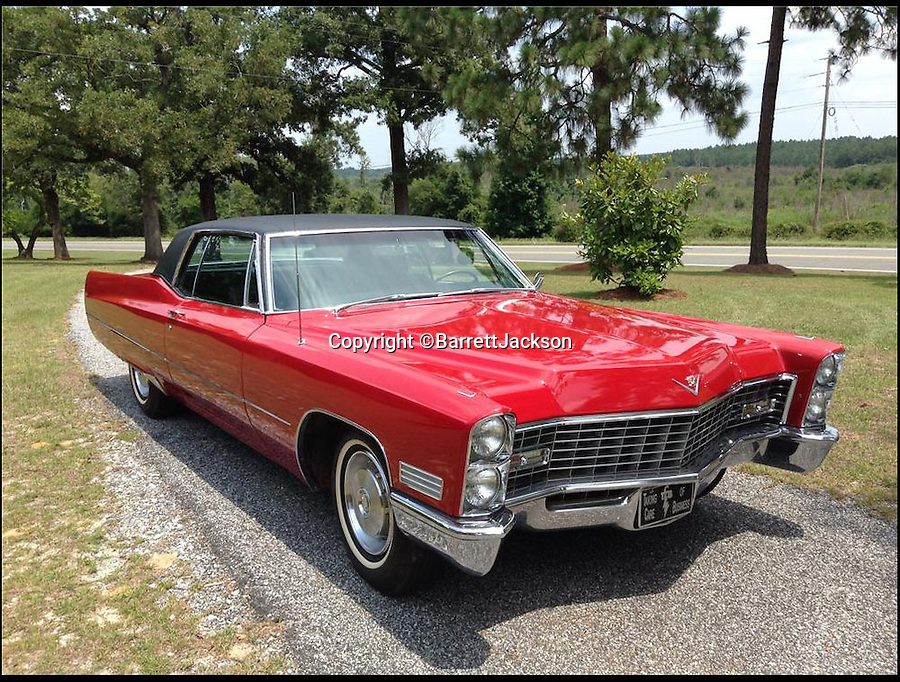 BNPS.co.uk (01202 558833)<br /> Pic: BarrettJAckson/BNPS<br /> <br /> ***Please Use Ful Byline***<br /> <br /> Elvis Preserly's Cadillac. <br /> <br /> A plush red Cadillac which Elvis Presley bought to drive on his honeymoon with Priscilla has sold for a whopping 55,000 pounds.<br /> <br /> The King snapped up the bright red motor after marrying wife Priscilla in Las Vegas on May 1, 1967 and the pair were often seen driving it around Memphis, home to Elvis' legendary Graceland mansion.<br /> <br /> The couple, who were married for six years, also used to drive the car to Elvis' 163-acre Circle G ranch in Mississippi where they spent some of their honeymoon.<br /> <br /> The 1967 Cadillac Coupe de Ville was bought by a private collector at a sale in Las Vegas held by classic car auctioneers Barrett Jackson.