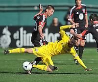 Perry Kitchen (23) of D.C. United goes against Eddie Gaven (12) of the Columbus Crew (12) The Columbus Crew defeated D.C. United 2-1 ,at RFK Stadium, Saturday March 23,2013.
