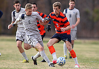 WASHINGTON, DC - NOVEMBER 25, 2012: Ian Christianson (6) of Georgetown University battles Louis Clark (7) of Syracuse University for the ball during an NCAA championship third round match at North Kehoe field, in Georgetown, Washington DC on November 25. Georgetown won 2-1 after overtime and penalty kicks.