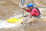 "Dale Griffiths of Patapsco takes advantage of the rain swollen Patapsco River to ""surf"" the waves while shooting the white water upstream."