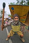 """A local portrays a farmer burning forest to make way for plantation. Sign reads """"Roast corn, not the forest"""""""