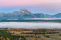 Teton National Park, Wyoming:<br /> Lingering fog in the Snake River valley with the Teton range in morning light